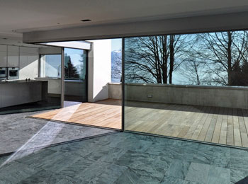 Moving glass walls glass design and build london ltd for Moving glass wall